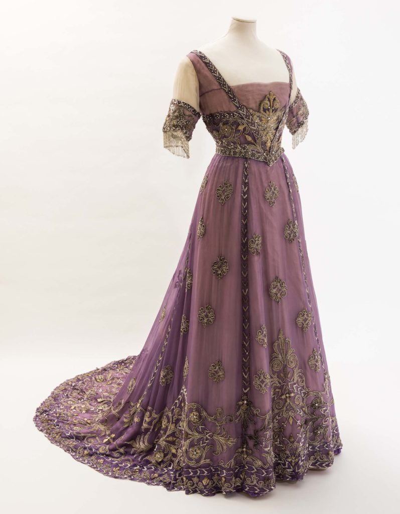 a photo of a voilet colored evening dress of the Edwardian period