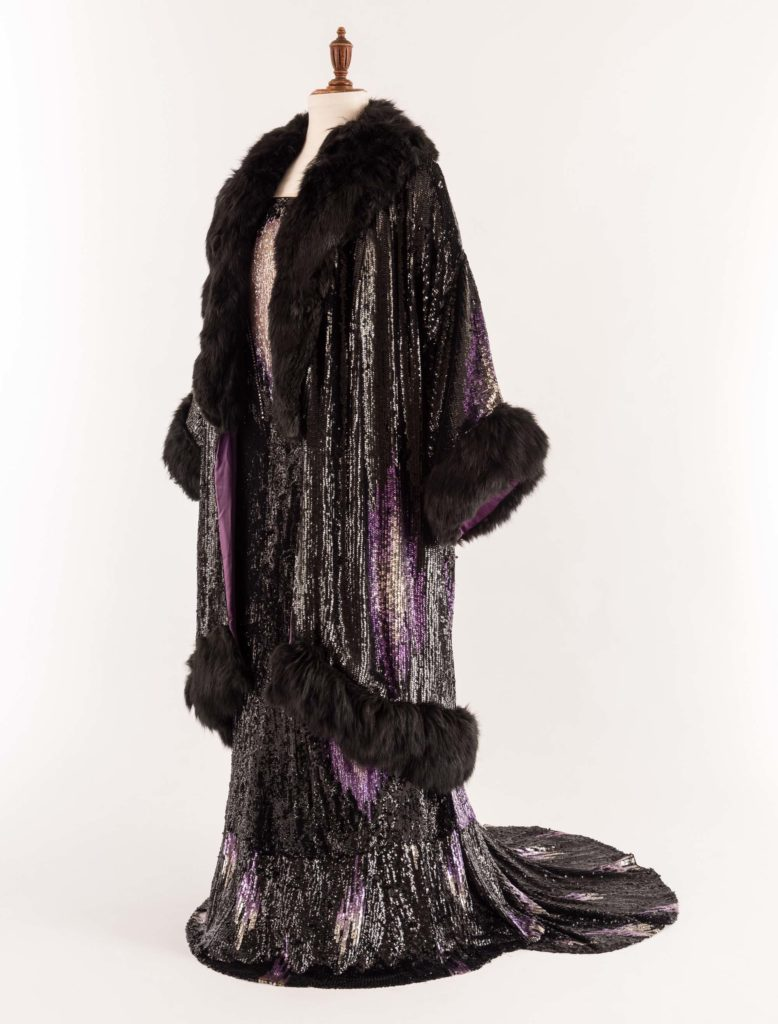 Sequinned evening dress and coat with a diamond pattern decorated with diamantés and trimmed with black foxaline fur