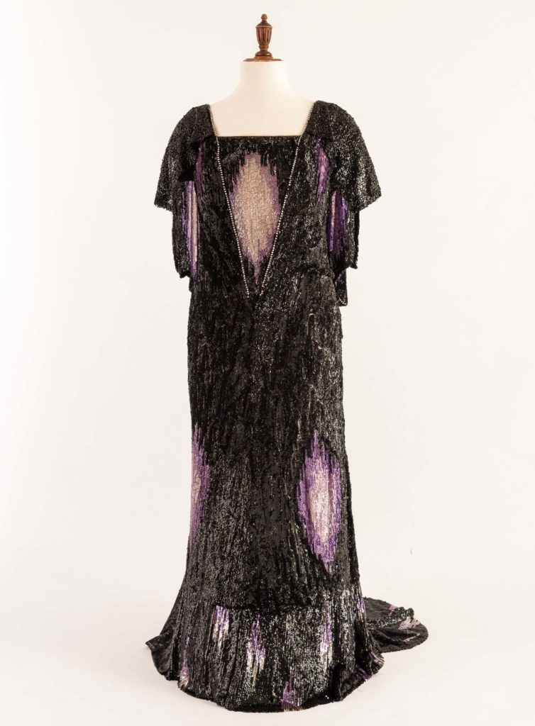 a photo of a evening gown with black and purple seqiins