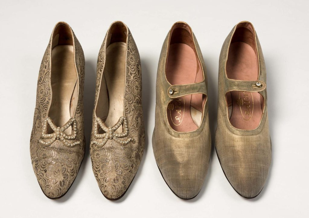 a photo of two pairs of golden shoes
