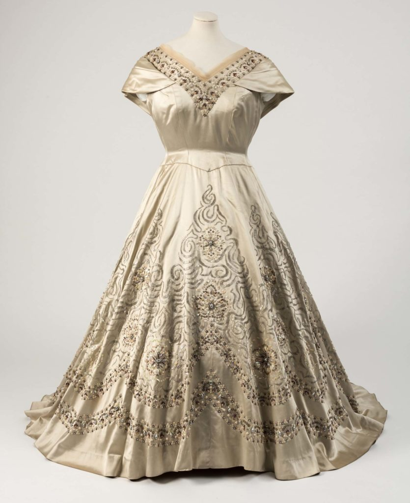 Gold lace evening dress embroidered all over with sequins and trimmed with soft net tulle