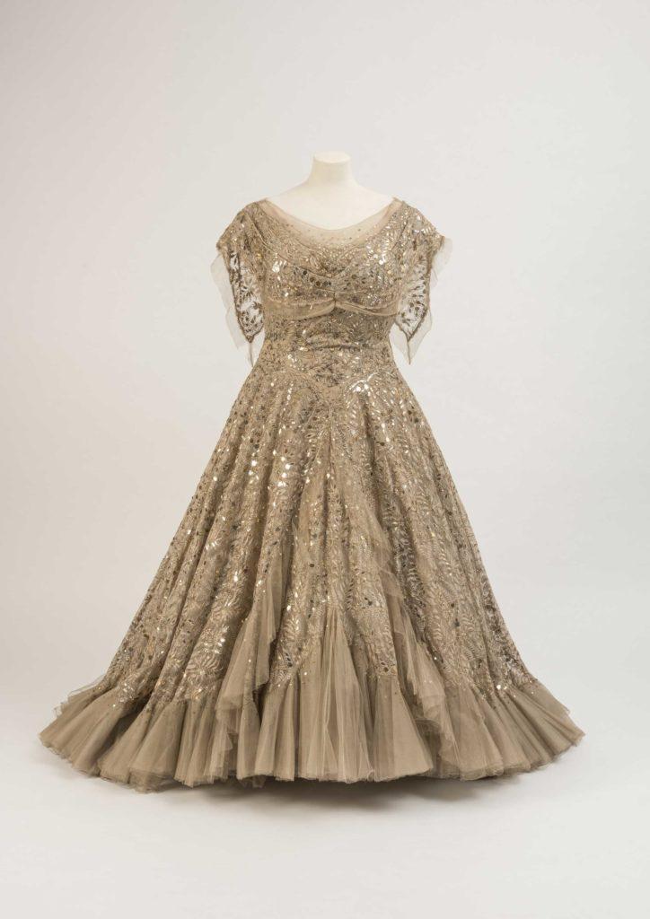 a photo of a silk off the shoulder evening dress