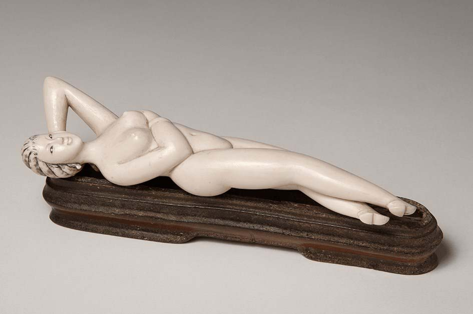a photo of an ivory carved naked female figure