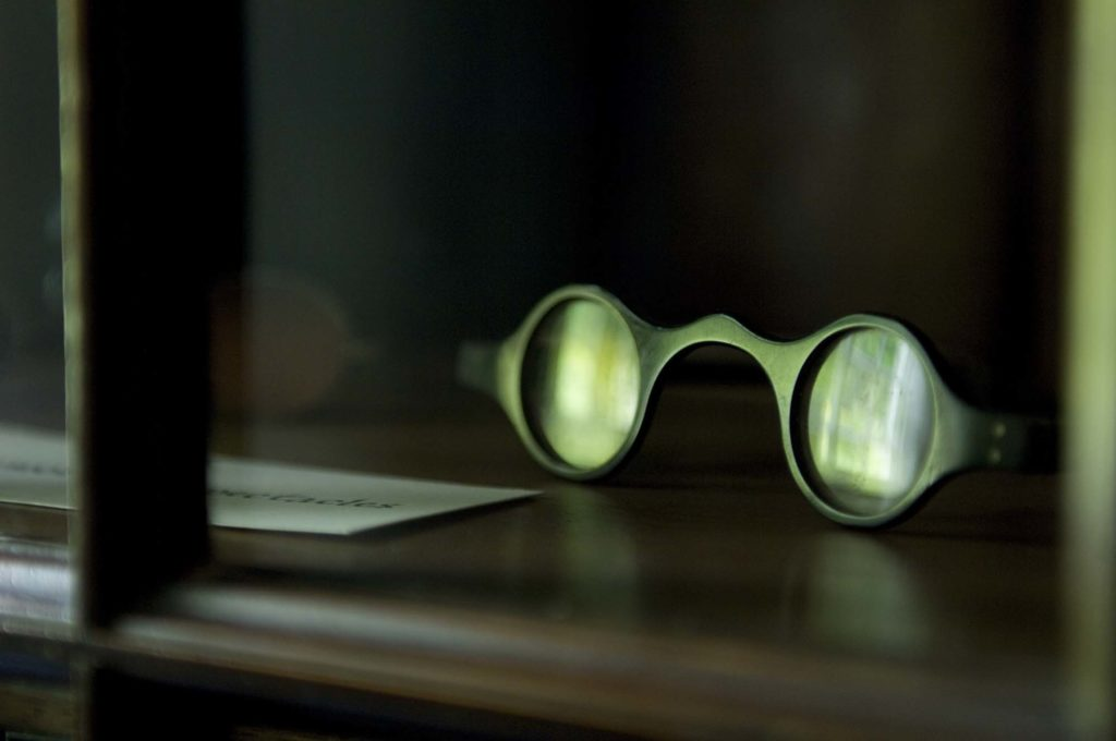 a photo of a pair of green-tinged spectacles