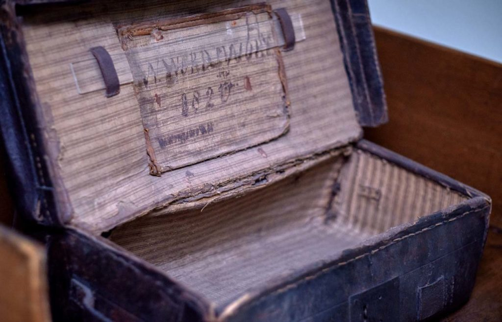 a photo of an old open suitcase with the words William Wordsworth