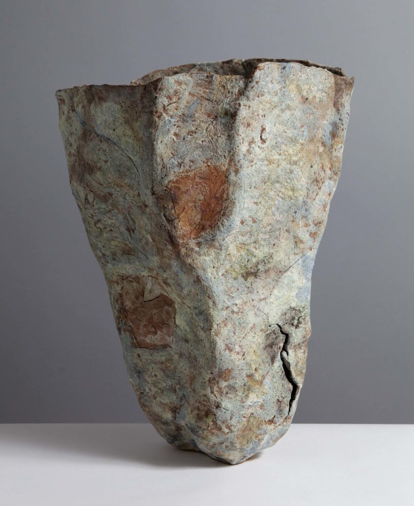 a photo of a pot made by Sara Radstone resembling a cloth like form