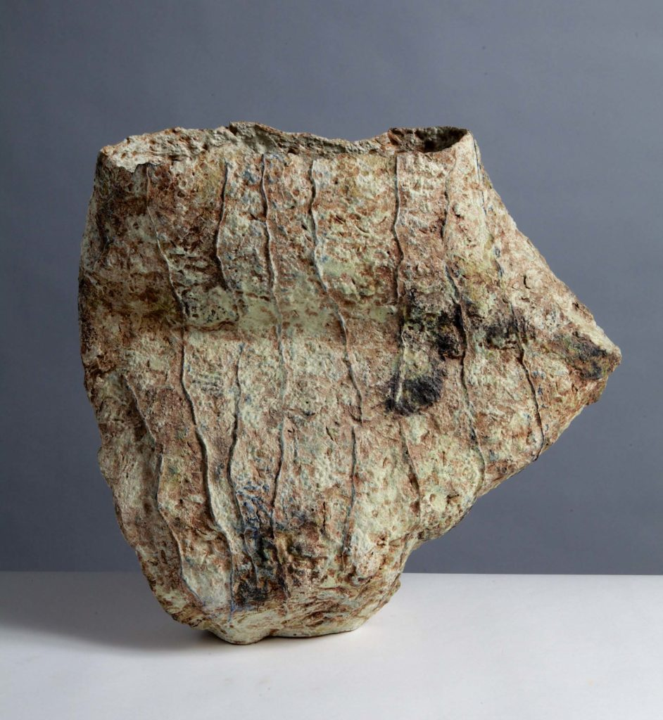 a photo of a ceramic vessel by Sara Radstone with a potruding side