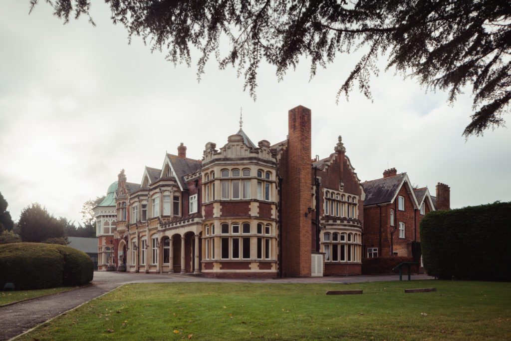 photograph of exterior of large mansion building in red brick