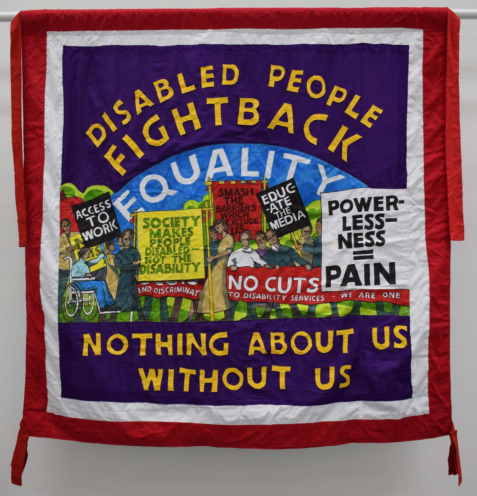 a banner with central panel depicting people on a march and the words disabled people fight back