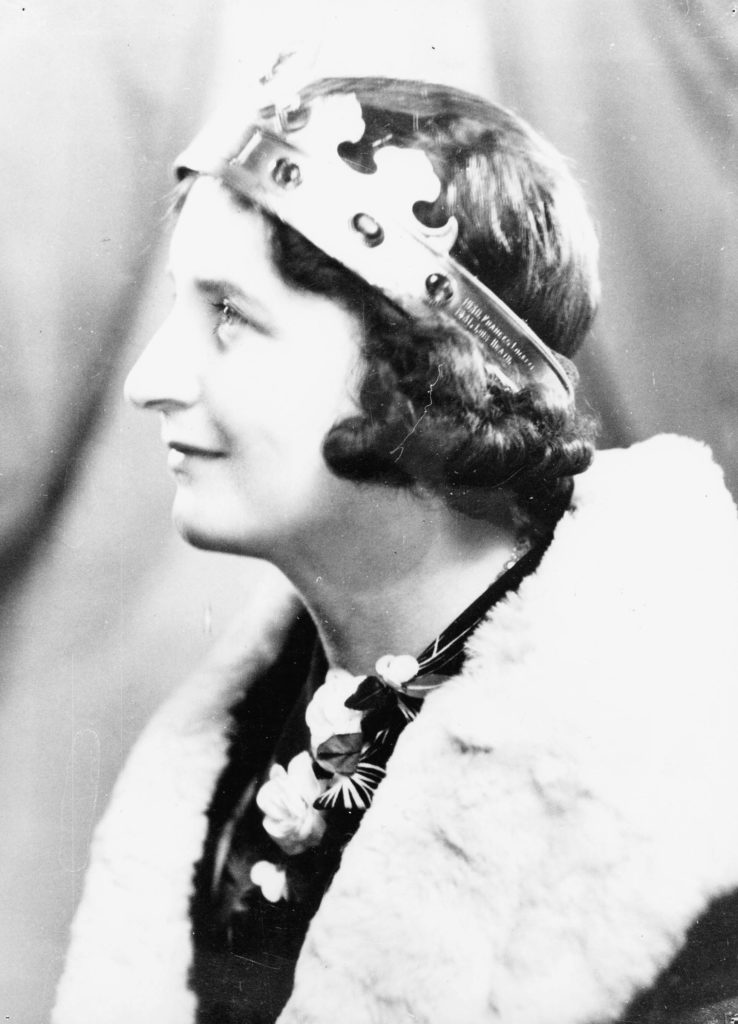 a photo of a young woman in side profile wearing a crown