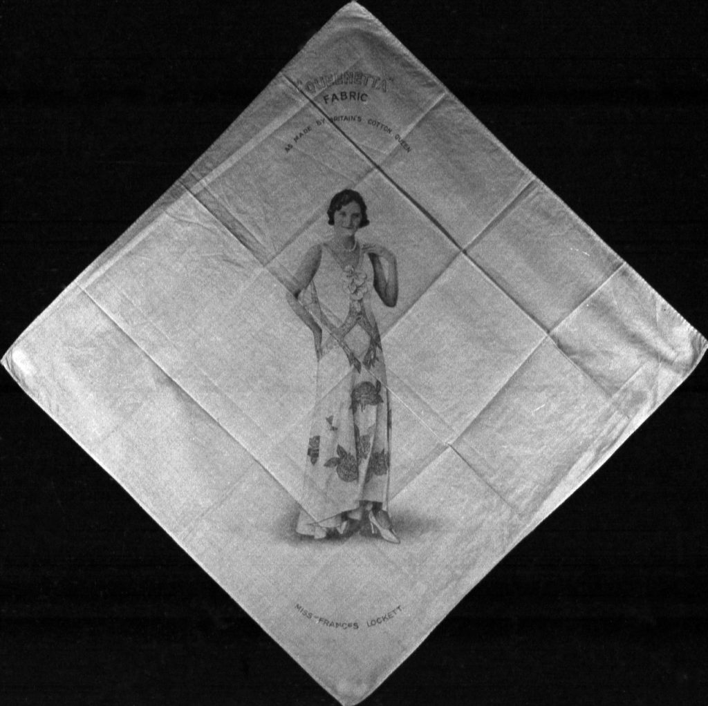 a photo of a cotton handkercheif with a photo of a woman in evening gown printed on to it
