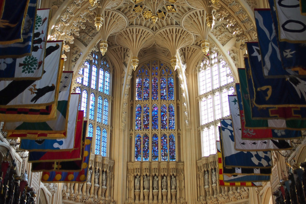 photograph showing interior of chapel westminster abbey, with flags and ornate ceiling