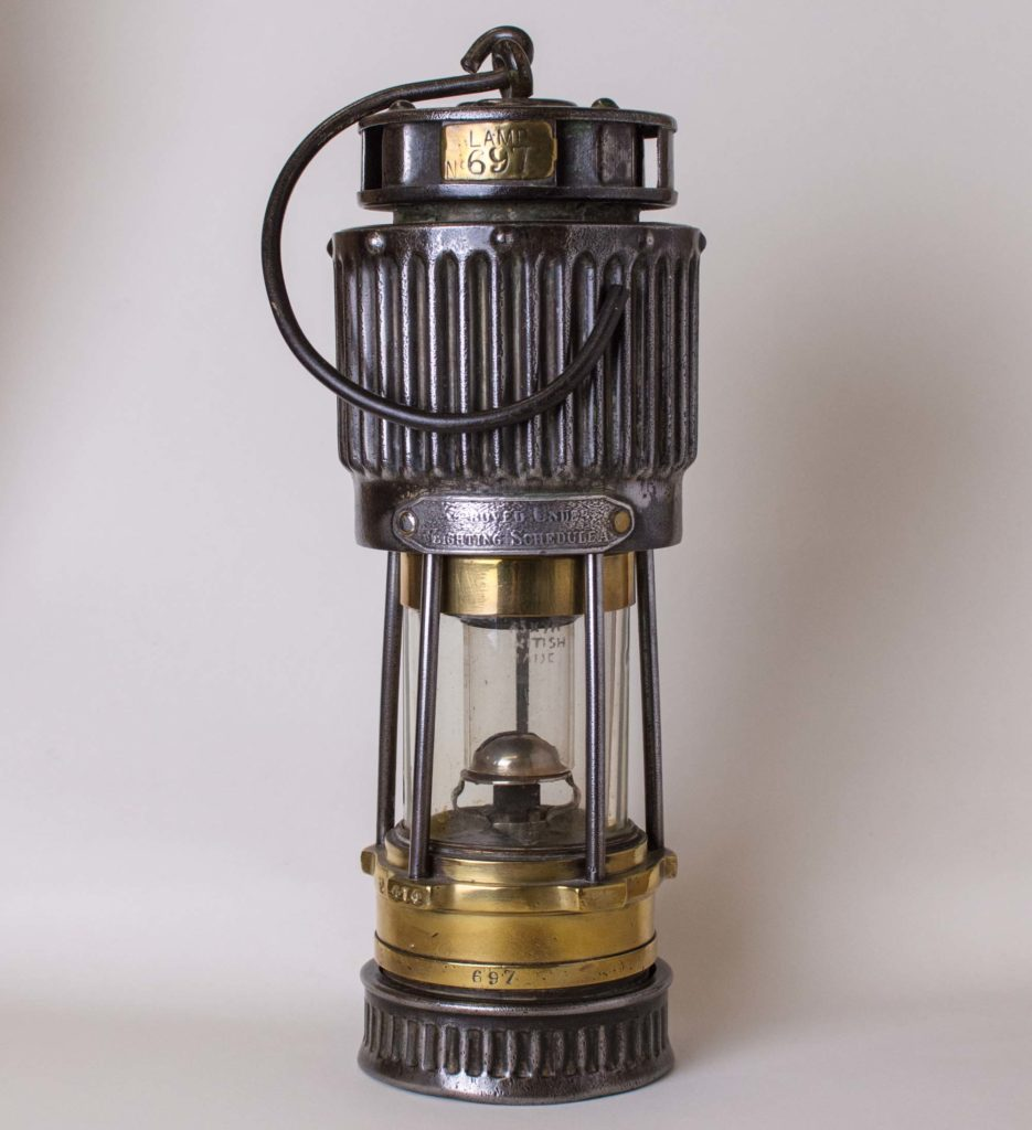 a photo of a lamp with a large ribbed upper chamber