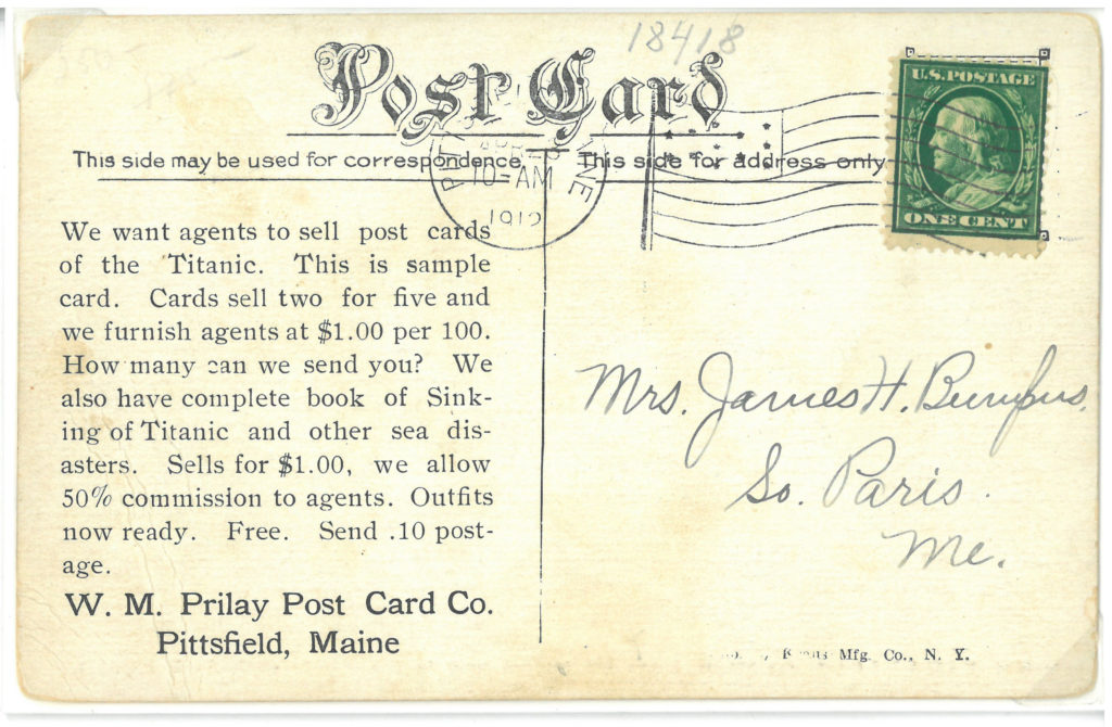 The reverse of the prior postcard. A man is showing an example of what he wants the postcards to look like so he can sell them.