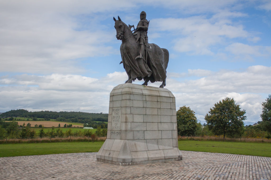 photograph of statue of man atop horse