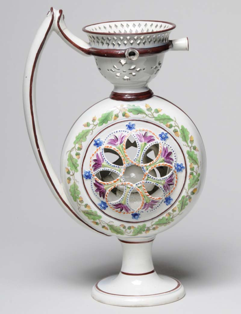 a photo of an ornate jug with hollow insides