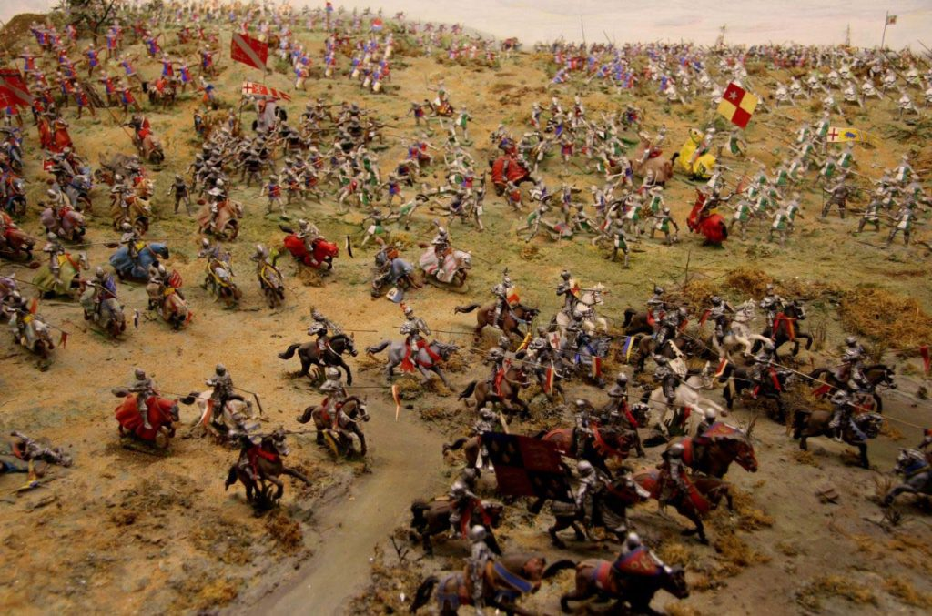 Photo of a model diorama showing the Battle of Bosworth. Small figures are shown in various phases of the battle.