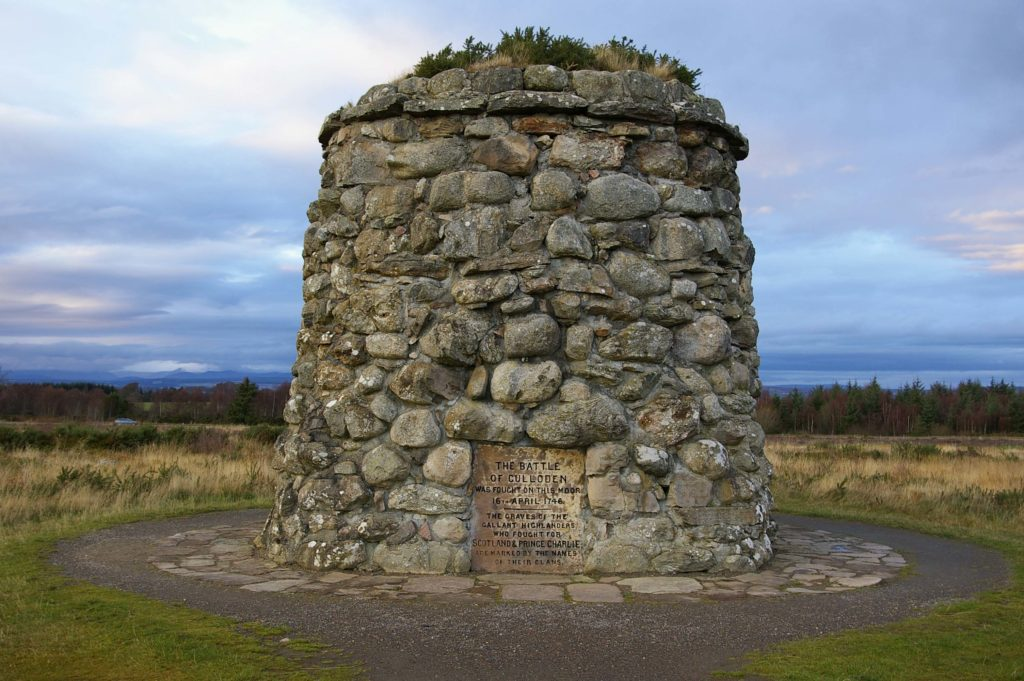 A large stone memorial for the soldiers of the highlands who died at the battle of Culloden
