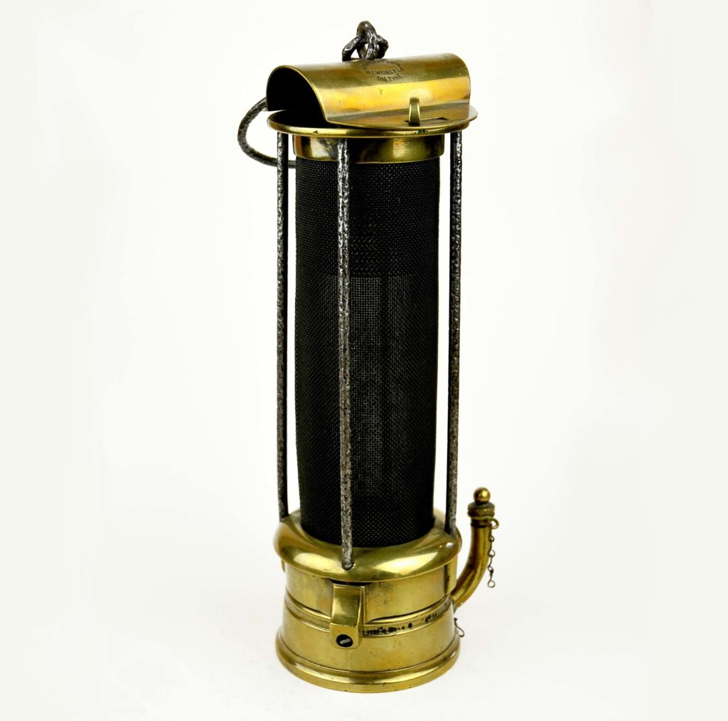 a photo of a brass lamp with central gauze