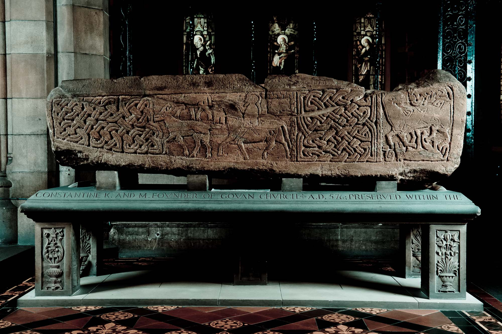 a photo of a stone coffin with Celtic decoration