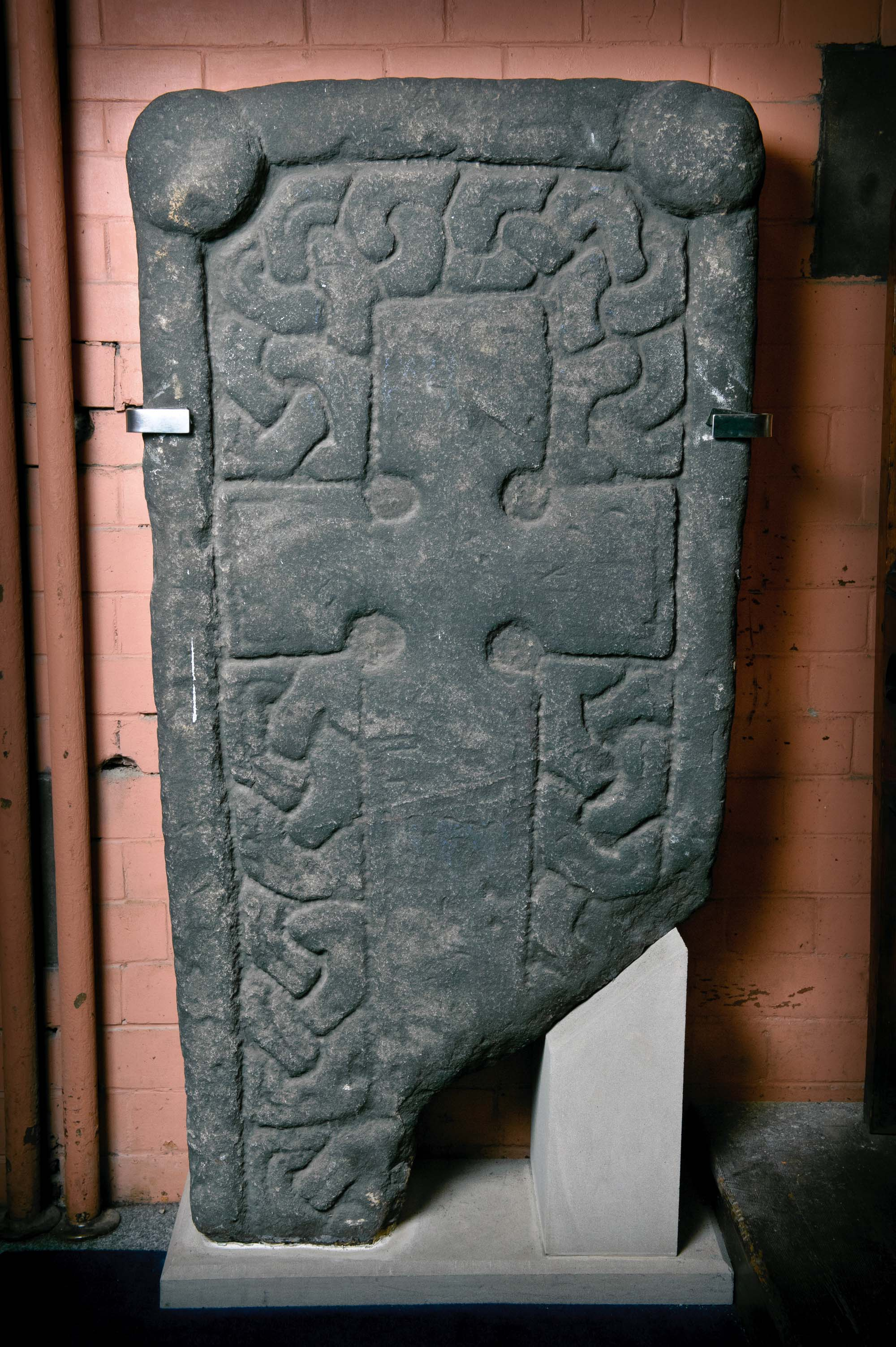 a photo of a stone decorated with a Celtic cross