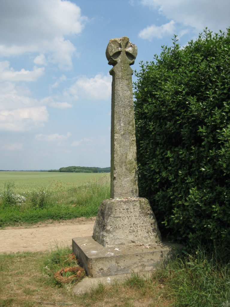 This depicts the memorial cross at the battle of Towton. It is a small stone cross with an inscription about the battle.