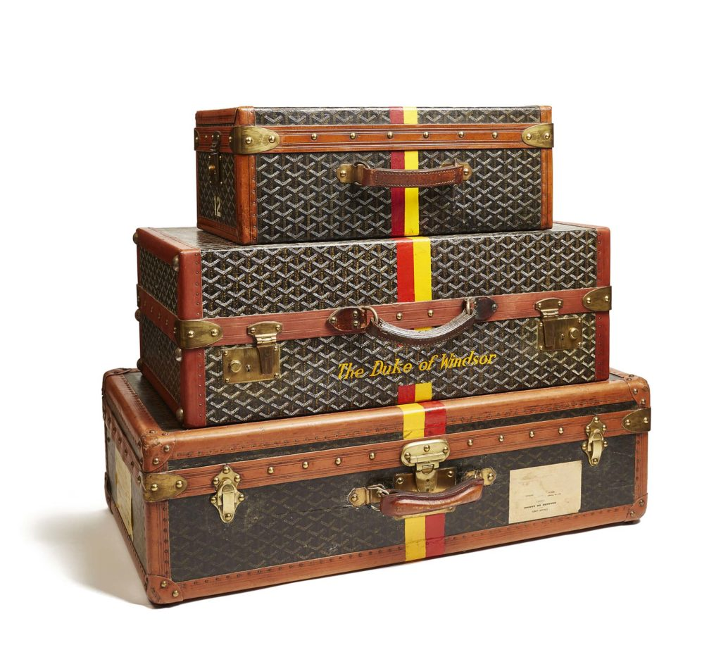 a photo of three pieces of luggage stacked upon each other