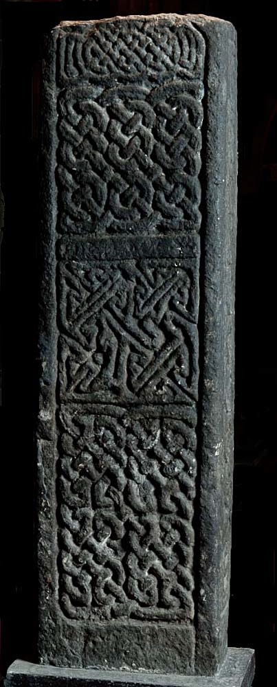 a close up of a pice of stonework with Celtic decoration