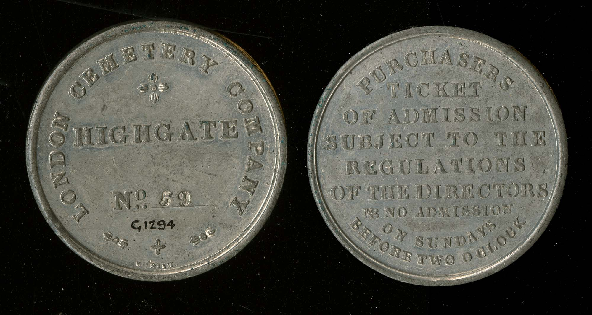 a photo of two sides of a round coin-like admission pass to Highgate Cemetery inscribed PURCHASERS TICKET OF ADMISSION SUBJECT TO THE REGULATIONS OF THE DIRECTORS NB NO ADMISSION ON SUNDAYS BEFORE TWO O'CLOCK.