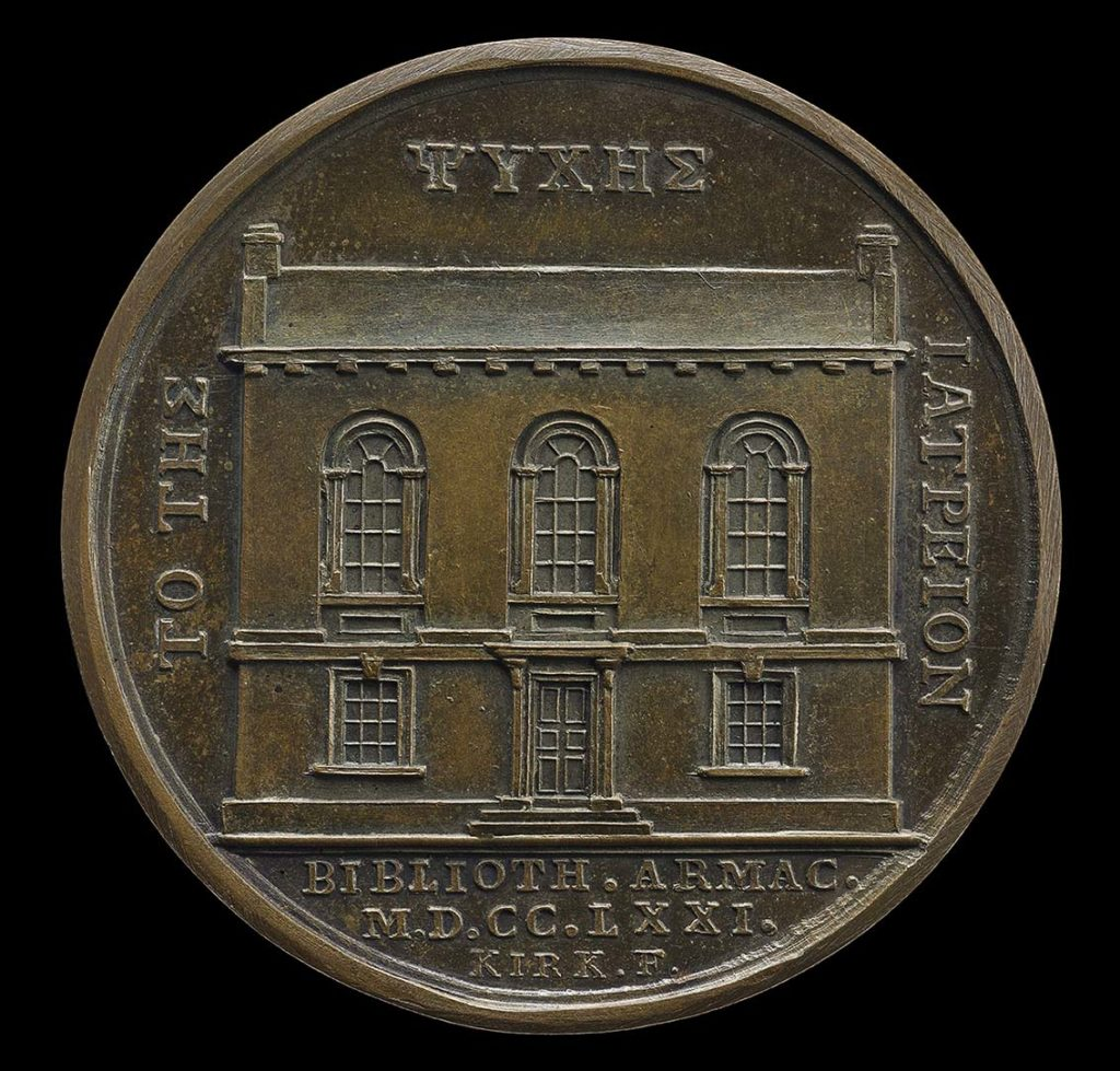 a bronze medal with a depiction of a two storey Georgian era building on it