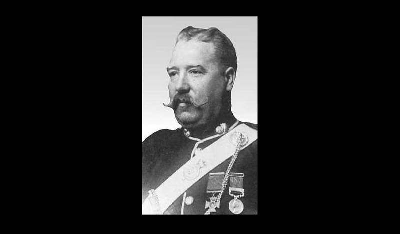 a black and white photo of a man with a handlebar moustache and militray uniform with a victoria cross medal pinned on it