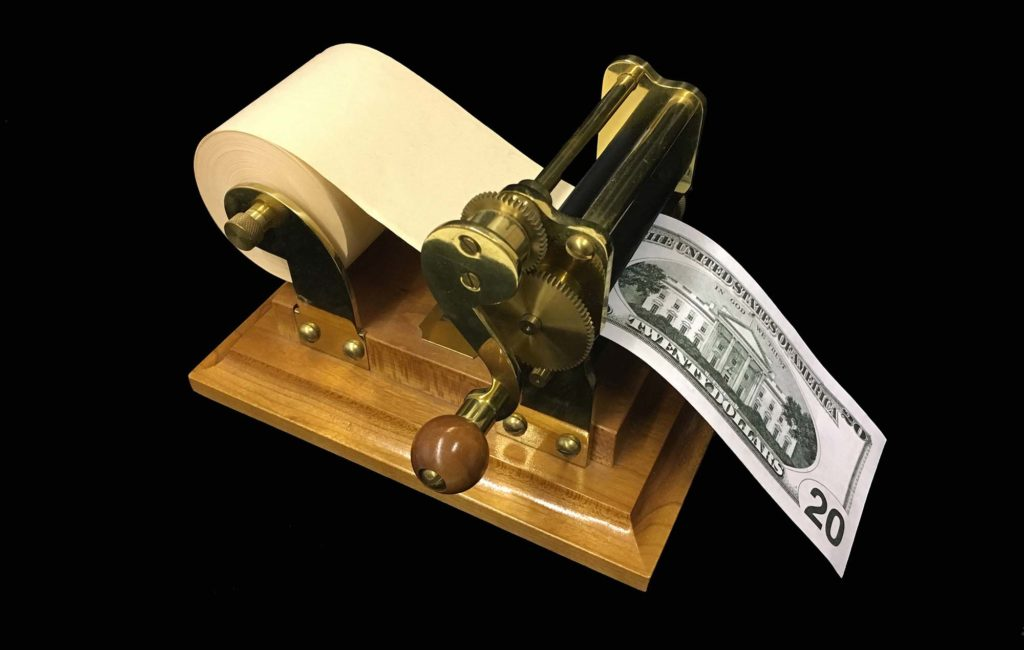 a photo of a machine with roll of paper printing a dollar