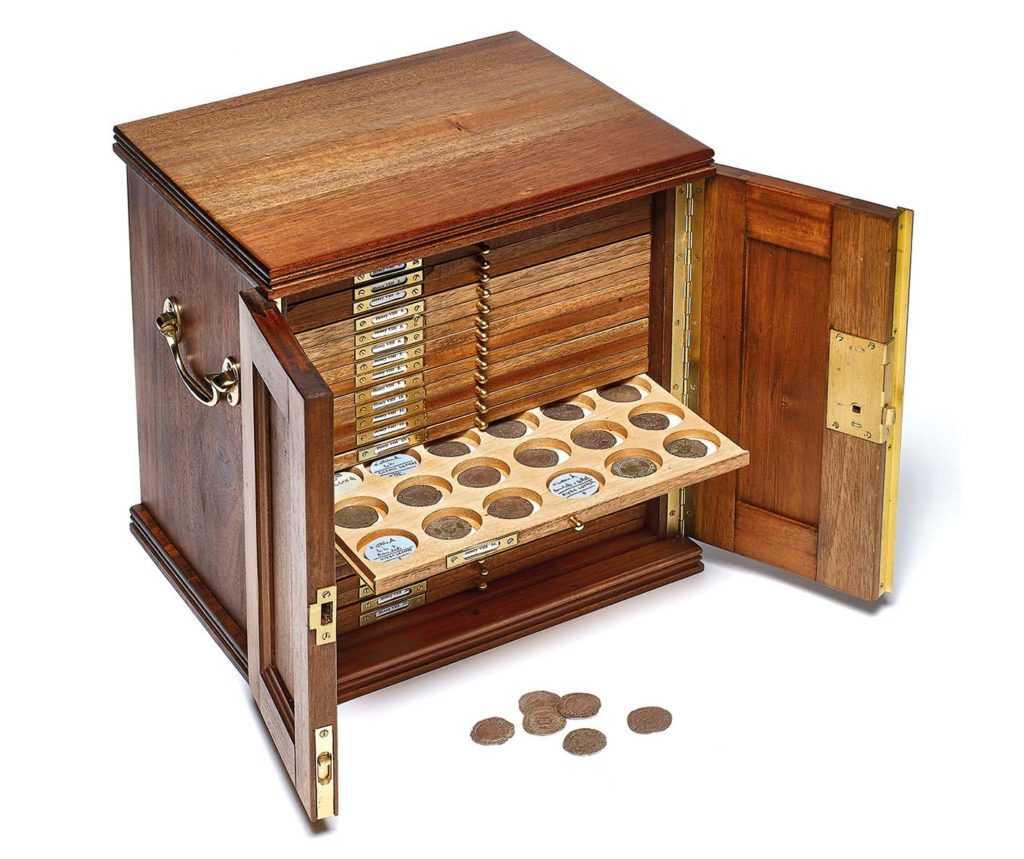 a photo of a money cabinet with drawers in it