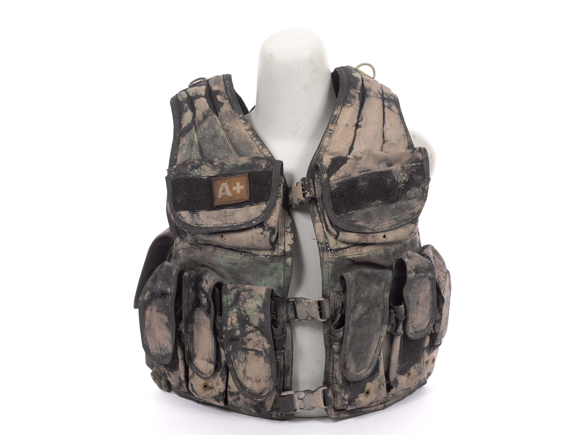 a photo of an armoured body vest camouflaged with green and brown