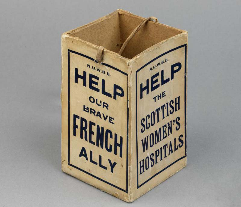 a photo of a cardboard box with help our brave French Allies on one side