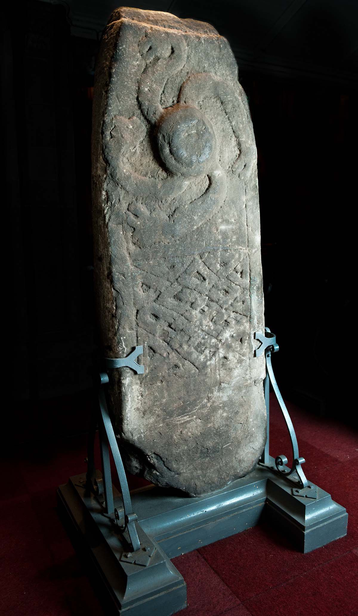 a photo of a stone with a sun-like decoration