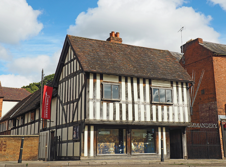 photograph of exterior of timber-framed building