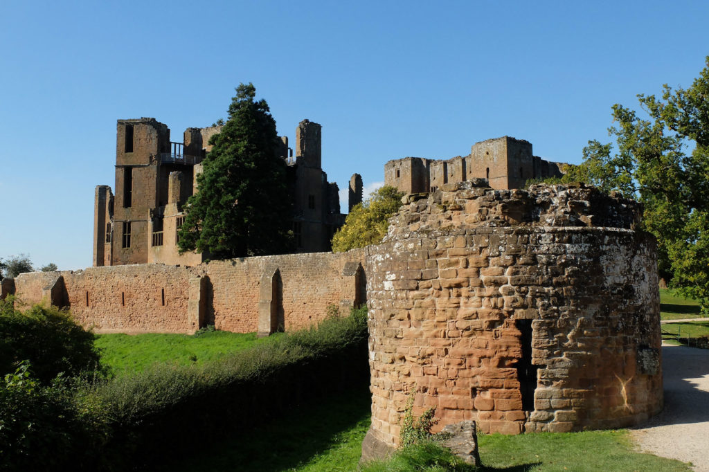 photograph of ruined red brick castle