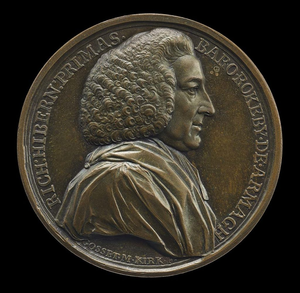 a bronze medal with a portrait of a man with Georgian era wig in profile