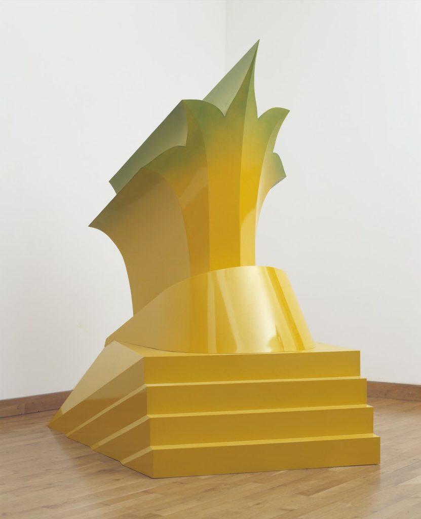 a yellow sculpture resembling a flower
