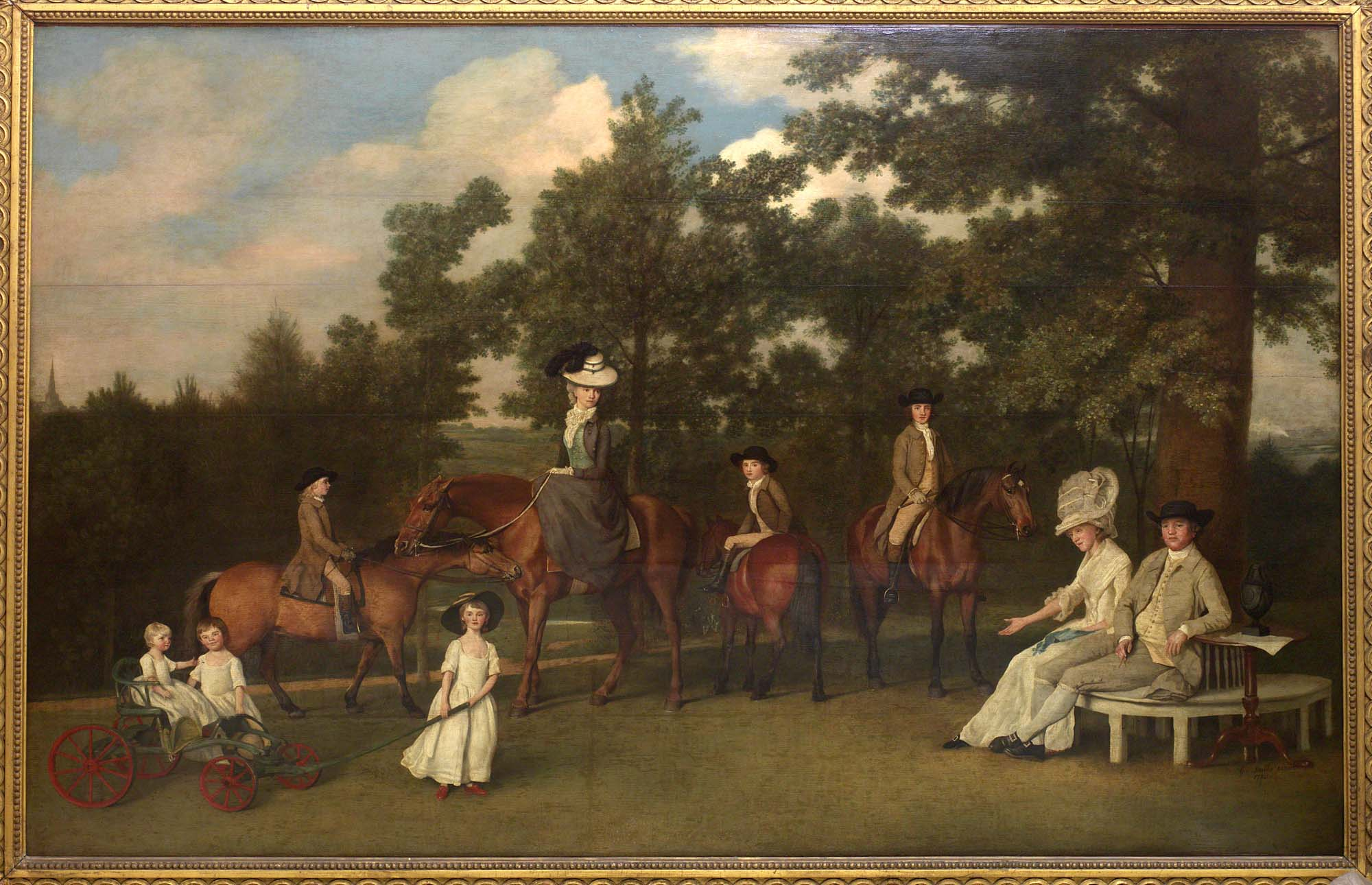 a group portrait of a Georgian family in a garden with horses