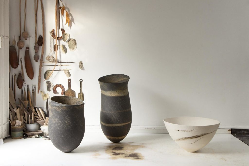 Three ceramic objects, two large grey vases and a white bowl