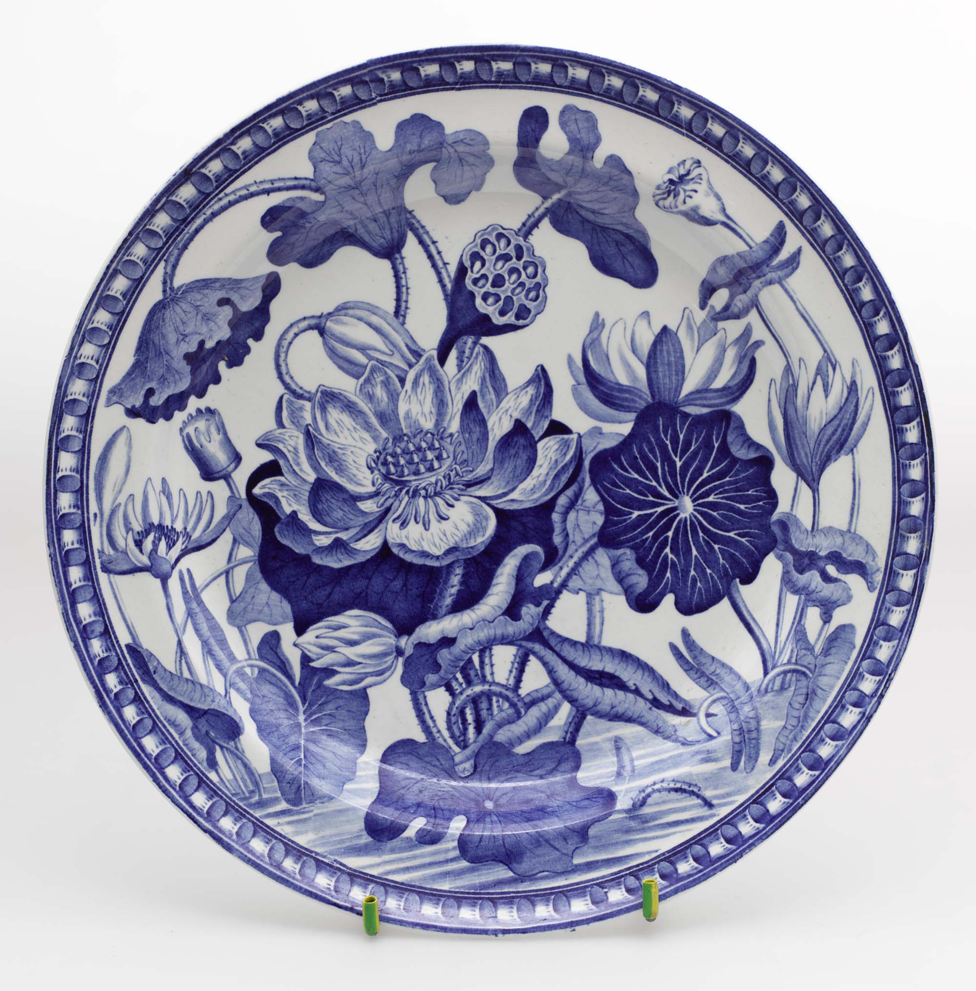 a photo of a blue dish with flower motif