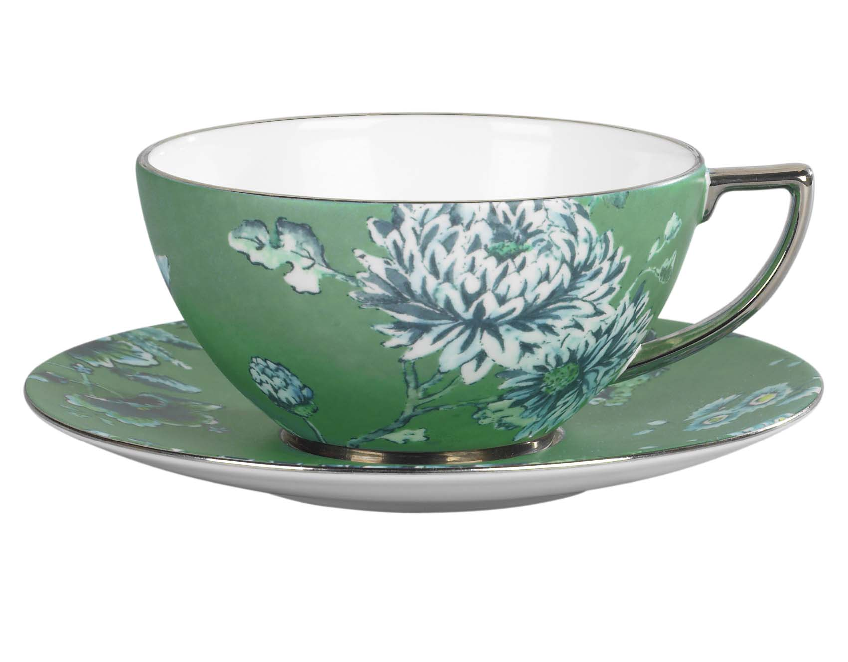 a photo of a green teacup and saucer with dellicate flower pattern