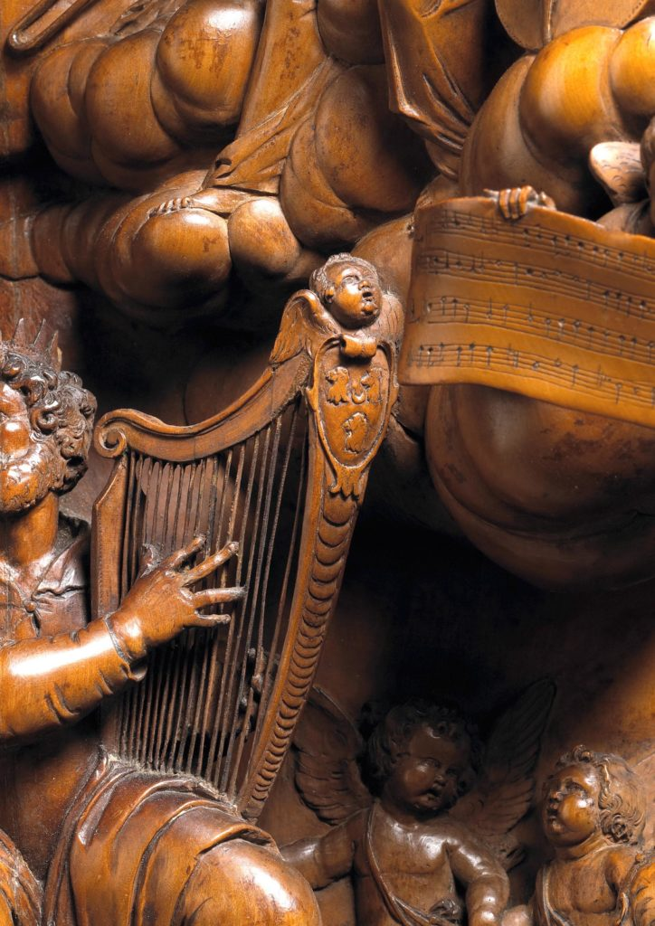 wooden carved panel, close up of a harp