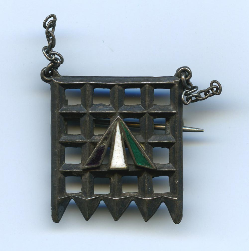a photo of a small portcullis styled brooch