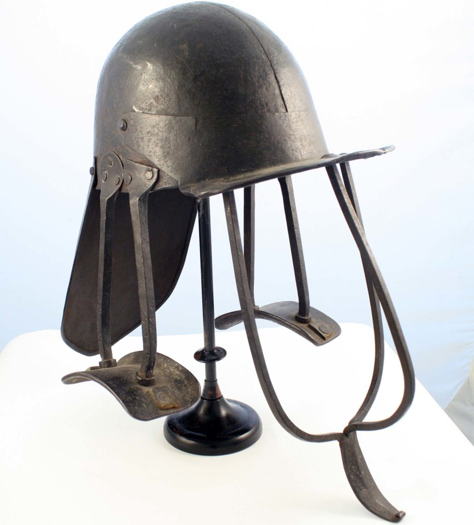 a photo of a large helmet with lobster tail, peak and iron supports reaching down to the shoulder