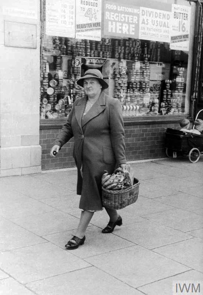 a photo of a woman with a shopping basket full of bananas