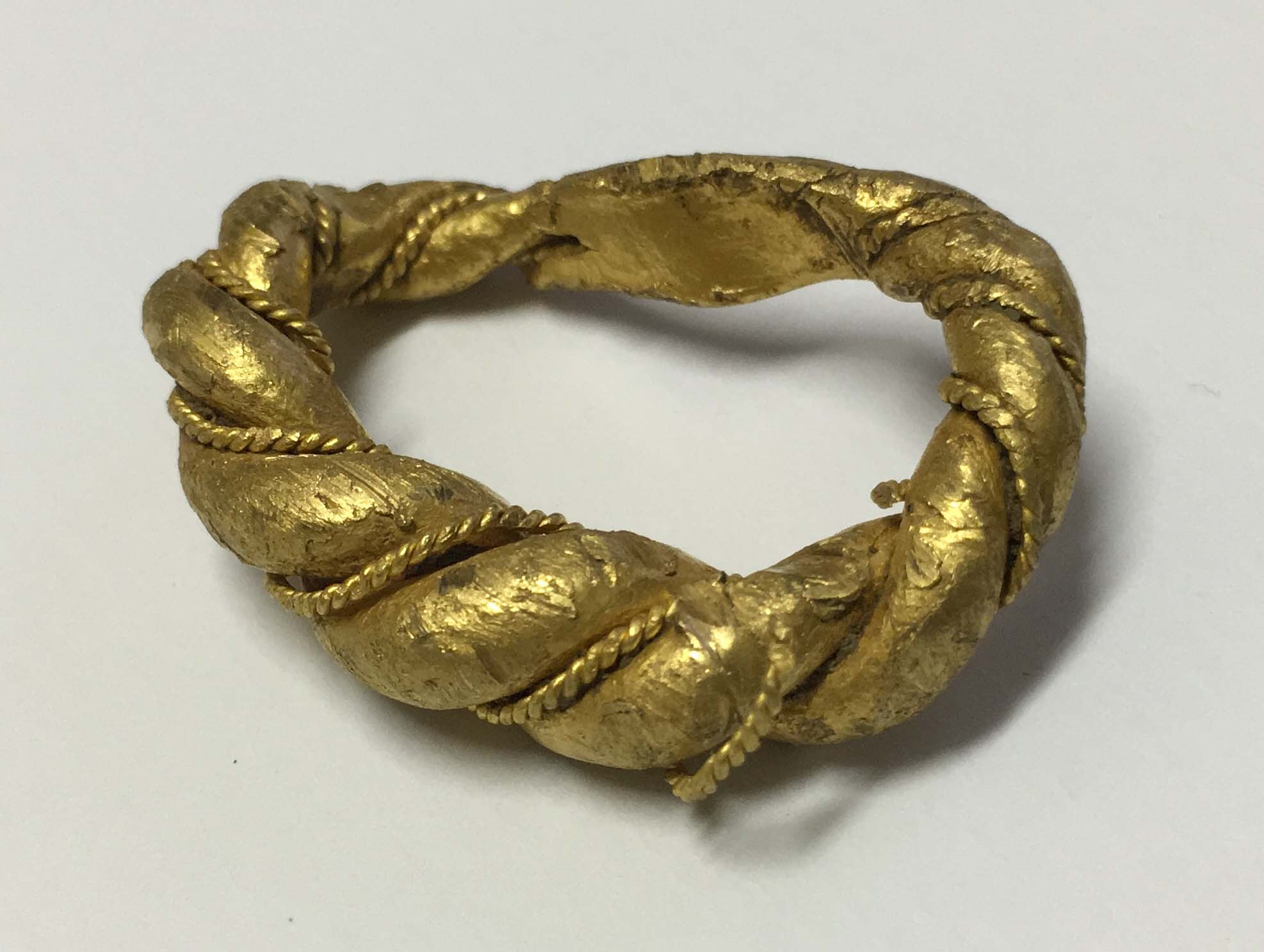 a weighty gold ring with twisting and wire beading