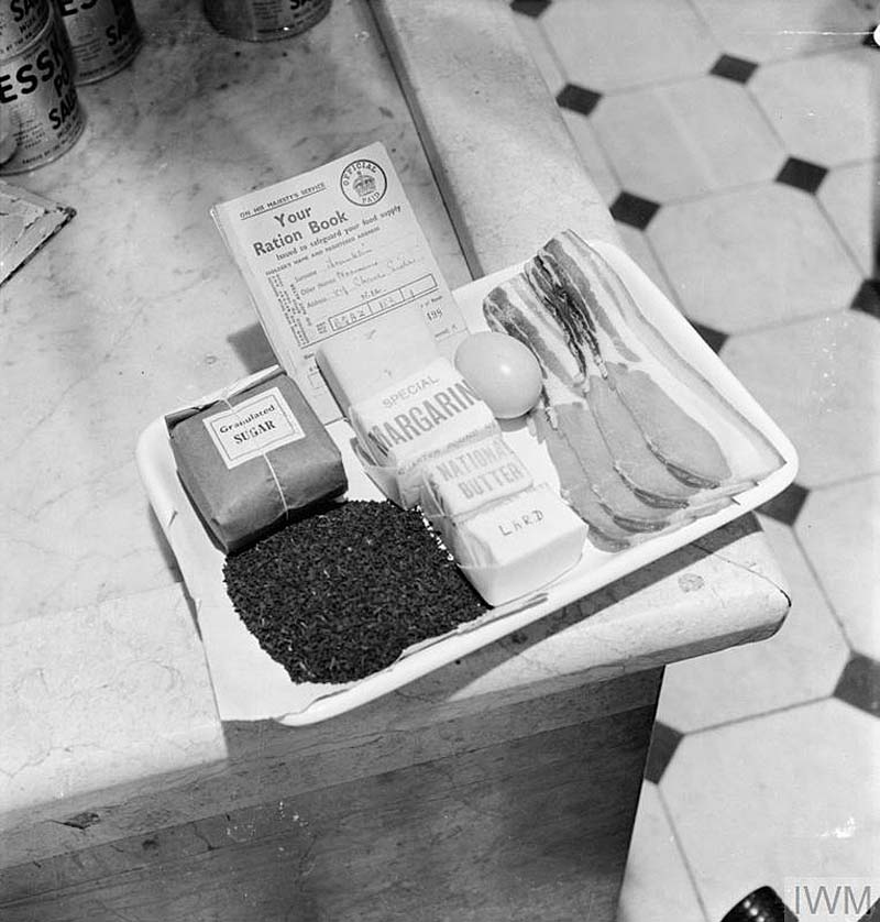 a black and white photo of a tray with food stuffs on it